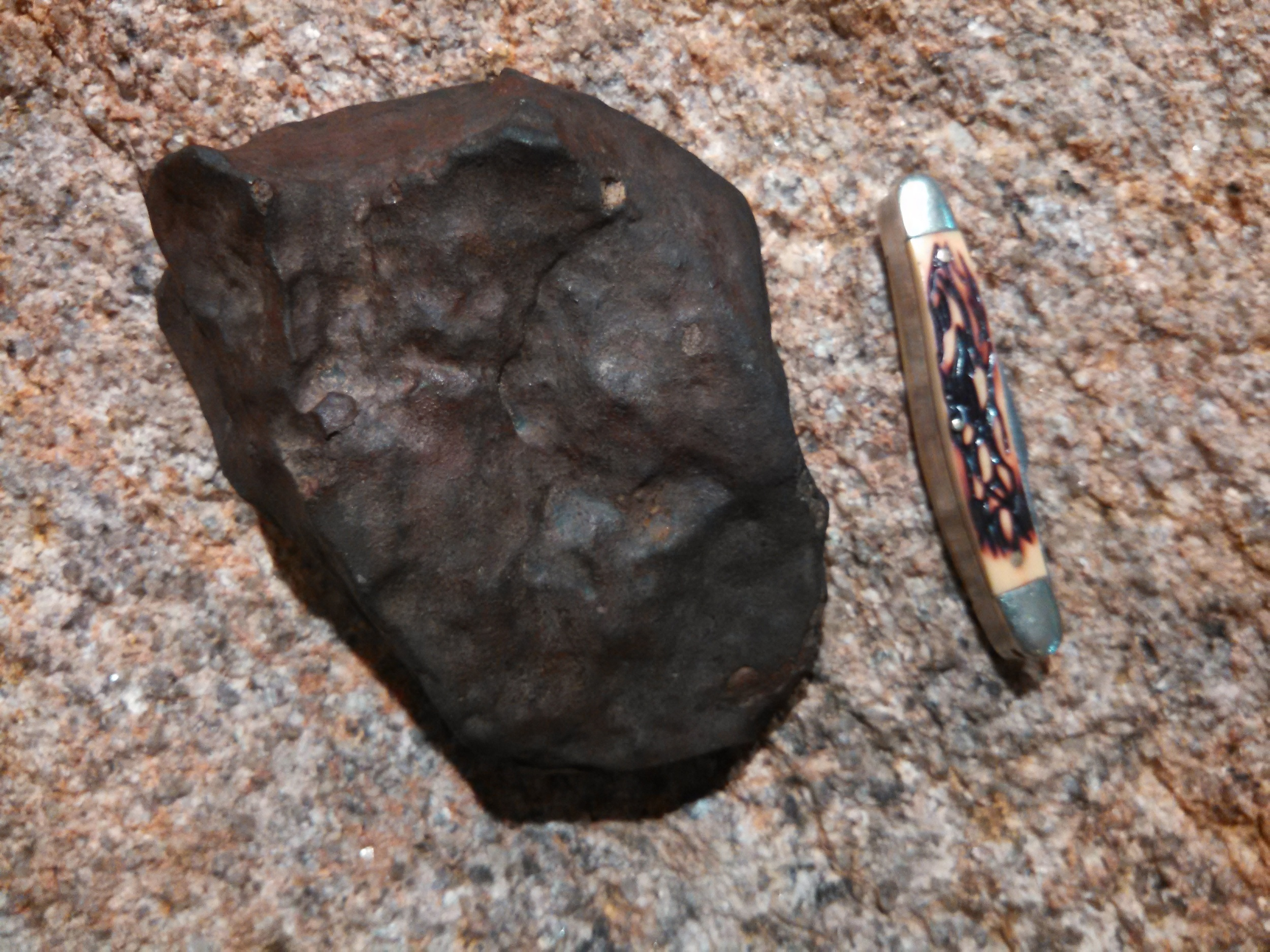 "The current Main Mass, found by an anonymous prospector. A funny story.. The prospector brought this stone to Keith Jenkerson who took one look at the stone and said, "" I know where you found that."" Keith had previously cut one of my stones for me and had seen several others. Bullhead City meteorites are very distinguishable and a practiced eye can spot one right away."