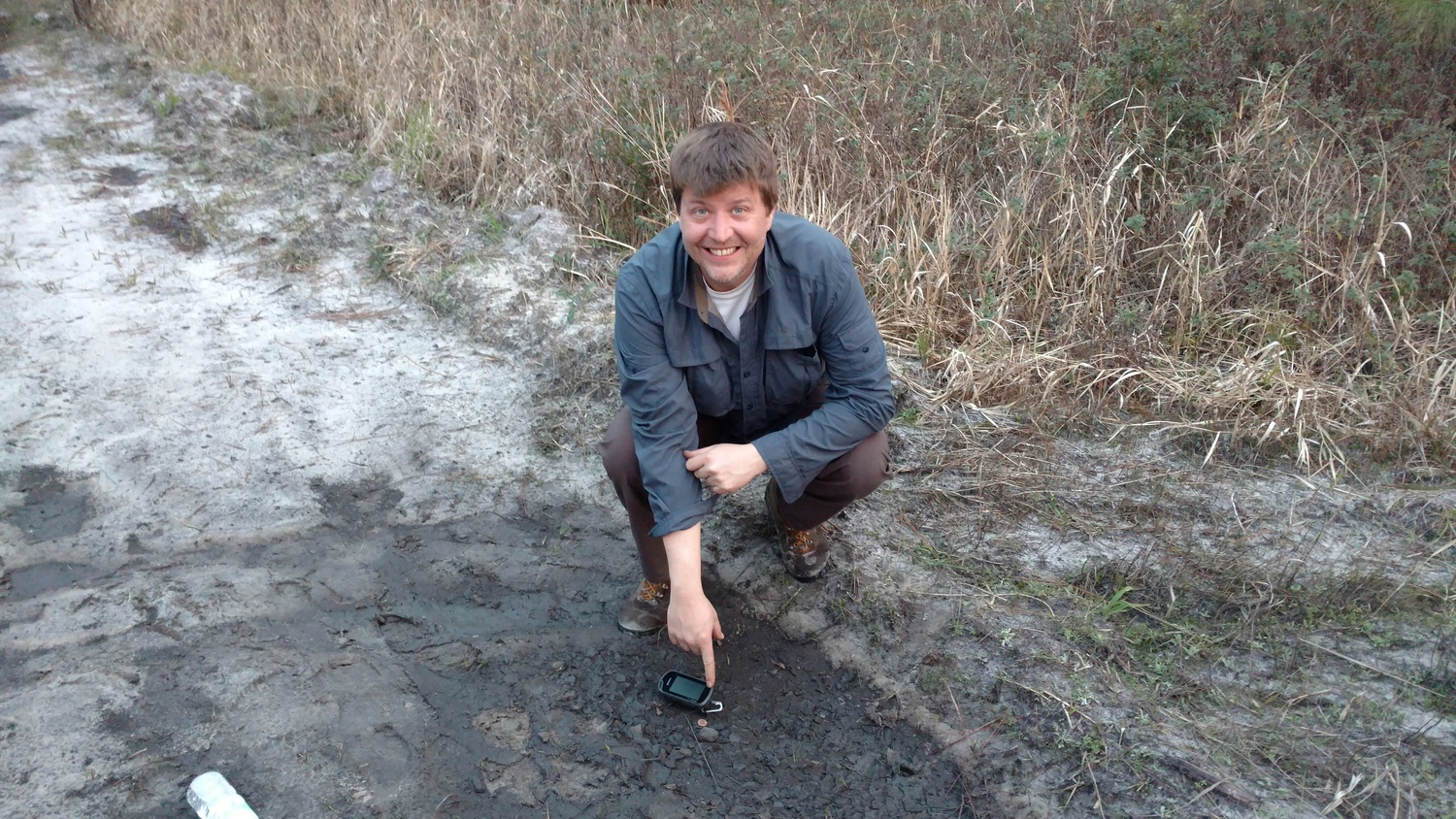 Mike's second find and it's in the mud puddle. - Photo Larry Atkins